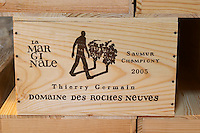 Bottles stored in the cellar. In cases. Domaine des Roches Neuves, Saumur Champigny, Loire, France