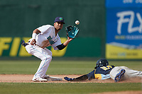 Lynchburg Hillcats shortstop Yordys Valdes (7) waits for a throw as Edmond Americaan (20) of the Myrtle Beach Pelicans slides head-first into second base during the game against the Myrtle Beach Pelicans at Bank of the James Stadium on May 23, 2021 in Lynchburg, Virginia. (Brian Westerholt/Four Seam Images)