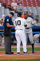 Trenton Thunder manager Tony Franklin (18) exchanges lineup cards with Connecticut Defenders manager Bienvenido Figueroa (10) and home plate umpire Chad Whitson at Dodd Stadium in Norwich, CT, Tuesday, June 3, 2008.