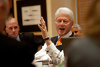 Former United States President Bill Clinton holds a vuvuzuela while speaking to memebers of the international press during a press conference at the Saxon Hotel in Sandhurst, Johannesburg, South Africa on June 24, 2010.  Clinton is the honorary chairman of the U.S. bid to host the World Cup in either 2018 or 2022.