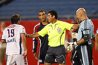 Referee Walter Quesada keep players separated. The New England Revolution defeated Pachuca CF 1-0 during a Group B match of the 2008 North American SuperLiga at Gillette Stadium in Foxborough, Massachusetts, on July 16, 2008.