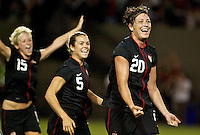 USWNT forward Abby Wambach celebrates her first goal with midfielder Kelley O'Hara and midfielder Megan Rapinoe. USWNT played played a friendly against Canada at JELD-WEN Field in Portland, Oregon on September 22, 2011.
