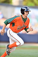 Greensboro Grasshoppers right fielder Walker Olis (7) runs to first base during a game against the Asheville Tourists at McCormick Field on April 27, 2017 in Asheville, North Carolina. The Tourists defeated the Grasshoppers 8-5. (Tony Farlow/Four Seam Images)
