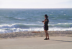 Asian woman using smart phone at the beach, Los Angeles, California, .  John leads private photo tours in Boulder and throughout Colorado. Year-round Colorado photo tours. .  John offers private photo tours throughout the western USA, especially Colorado. Year-round.