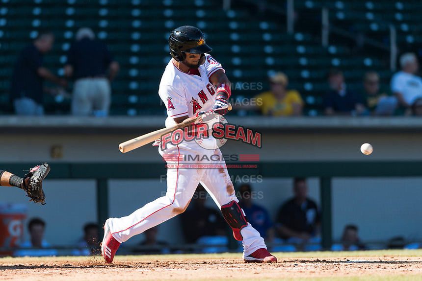 Mesa Solar Sox third baseman Roberto Baldoquin (24), of the Los Angeles Angels organization, swings at a pitch during an Arizona Fall League game against the Salt River Rafters at Sloan Park on October 30, 2018 in Mesa, Arizona. Salt River defeated Mesa 14-4 . (Zachary Lucy/Four Seam Images)