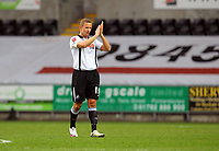 ATTENTION SPORTS PICTURE DESK<br /> Pictured: Lee Trundle thanking Swansea supporters at the end of the game<br /> Re: Coca Cola Championship, Swansea City Football Club v Sheffield Wednesday at the Liberty Stadium, Swansea, south Wales. Saturday 13 Marchy 2010