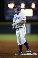 Trevor Jones (40) of the Western Carolina Catamounts is all smiles after his pinch-hit RBI single during the game against the St. John's Red Storm at Childress Field on March 13, 2021 in Cullowhee, North Carolina. (Brian Westerholt/Four Seam Images)