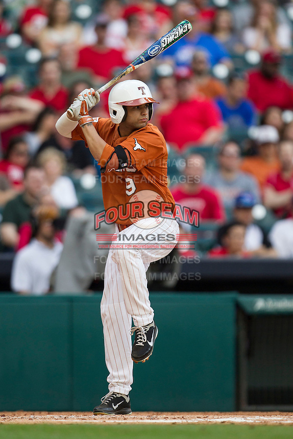 Texas Longhorns shortstop CJ Hinojosa #9 at bat during the NCAA baseball game against the Houston Cougars on March 1, 2014 during the Houston College Classic at Minute Maid Park in Houston, Texas. The Longhorns defeated the Cougars 3-2. (Andrew Woolley/Four Seam Images)