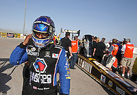 Apr. 7, 2013; Las Vegas, NV, USA: NHRA top fuel dragster runner-up Antron Brown reacts after losing in the final round of the Summitracing.com Nationals at the Strip at Las Vegas Motor Speedway. Mandatory Credit: Mark J. Rebilas-