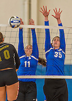 18 October 2015: Yeshiva University Maccabee Setter, Defensive Specialist, and team co-Captain Aliza Muller (11), a Senior from Los Angeles, CA, and Middle Blocker Gavriela Colton (35), a Junior from Teaneck, NJ,  jump to block during game action against the College of Mount Saint Vincent Dolphins at the Peter Sharp Center, in Riverdale, NY. The Dolphins defeated the Maccabees 3-0 in the NCAA Division III Women's Volleyball Skyline matchup. Mandatory Credit: Ed Wolfstein Photo *** RAW (NEF) Image File Available ***