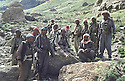 Iraq 1983  <br /> Qandil, In the middle,Idris Barzani with peshmergas, left in front, Najmadin Yousefi   <br /> Irak 1983 <br /> A Qandil, au milieu assis, Idris Barzani avec des peshmergas, devant a gauche, Najmadin Yousefi