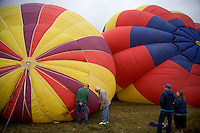 Hot air balloon pilots prepare their balloons for inflation before the Great Prosser Balloon Rally in Prosser, Washington, USA.