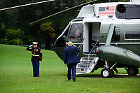 United States President Donald J. Trump salutes the Marine Guard as he boards Marine One on South Lawn of the White House in Washington, D.C., U.S., on Thursday, September 24, 2020. <br /> CAP/MPI/RS<br /> ©RS/MPI/Capital Pictures