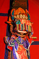 Bull-headed, red-haired protector deity of the Gelugpa Buddhist order, with tiara of skulls, covered by tasseled silk cloth, at Ramoche Temple, built in the 7th century, sister to the Jokhang Temple, Lhasa, Tibet, China.