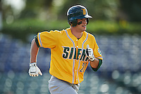 Siena Saints center fielder Dan Swain (22) runs to first base during a game against the Pittsburgh Panthers on February 24, 2017 at Historic Dodgertown in Vero Beach, Florida.  Pittsburgh defeated Siena 8-2.  (Mike Janes/Four Seam Images)