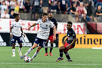 FOXBOROUGH, MA - AUGUST 18: Drew Skundrich #12 of D.C. United dribbles as Wilfrid Kaptoum #5 of New England Revolution defends during a game between D.C. United and New England Revolution at Gillette Stadium on August 18, 2021 in Foxborough, Massachusetts.