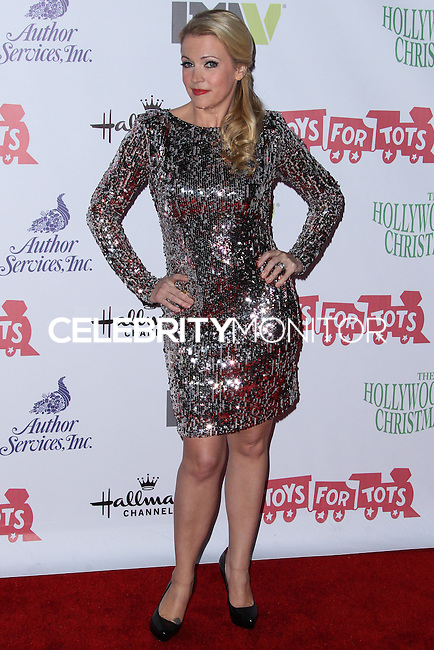 HOLLYWOOD, CA - DECEMBER 01: Actress Melissa Joan Hart arrives at the 82nd Annual Hollywood Christmas Parade held at Hollywood Boulevard on December 1, 2013 in Hollywood, California. (Photo by Xavier Collin/Celebrity Monitor)