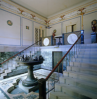 The double staircase of the entrance hall to Charlottenhof features an ornate fountain and is decorated with medallions and a gouache and paper frieze