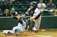 Rey Navarro #28 of the Wilmington Blue Rocks is tagged out at home plate by Luis Sierra #7 of the Winston-Salem Dash at BB&T Ballpark on April 23, 2011 in Winston-Salem, North Carolina.   Photo by Brian Westerholt / Four Seam Images