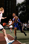 Austin Freeman (3) makes a pass in front of Kyle Singler (33) during the Elite 24 Hoops Classic game on September 1, 2006 held at Rucker Park in New York, New York.  The game brought together the top 24 high school basketball players in the country regardless of class or sneaker affiliation.