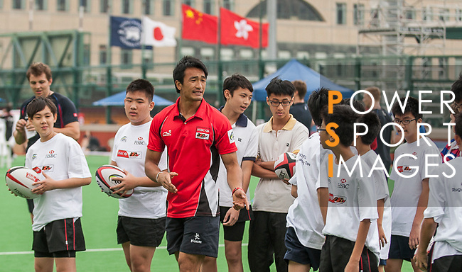 Hong Kong team player Salom Yiu conducts a clinic with kids ahead the HSBC Asian Five Nations 2013 Top 5 Division Women match at the Hong Kong Football Club on 27 April 2013 in Hong Kong. Photo by Xaume Olleros / The Power of Sport Images