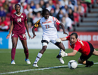 Rachelle Beanlands (33) of Maryland tries to save the ball from going over the end line after being cleared by teammate Shade Pratt (22) with Tiffany McCarty (14) of Florida State behind during the game at Ludwing Field in College Park, MD.  Florida State defeated Maryland, 1-0.