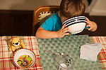 My younger son, age three, set a place for his lion (originally his older brother's) at the breakfast table.