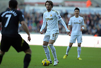 Saturday, 08 December 2012<br /> Pictured: (L-R) Robert Snodgrass, Michu and Ki Sun-Yueng.<br /> Re: Barclays Premier League, Swansea City FC v Norwich City at the Liberty Stadium, south Wales.