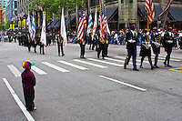 Little boy watches as the parade passes by.