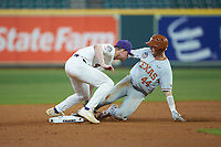 Austin Todd (44) of the Texas Longhorns is tagged out by Cade Doughty (4) of the LSU Tigers as he tries to steal second base in game three of the 2020 Shriners Hospitals for Children College Classic at Minute Maid Park on February 28, 2020 in Houston, Texas. The Tigers defeated the Longhorns 4-3. (Brian Westerholt/Four Seam Images)