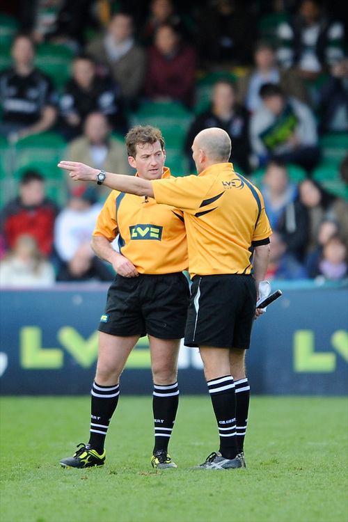 Referee Mr J P Doyle (left) discusses with one of the Assistant Referees during the LV= Cup Final match between Leicester Tigers and Northampton Saints at Sixways Stadium, Worcester on Sunday 18 March 2012 (Photo by Rob Munro, Fotosports International)