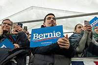 People listen as Jane O'Meara Sanders, wife of Democratic presidential candidate and Vermont senator Bernie Sanders, speaks at a campaign rally at Hampshire Hills Athletic Club in Milford, New Hampshire, on Tue., Feb. 4, 2020. The  event started around 7pm and was the first event Sanders held after the previous day's Iowa Caucuses. The results of the caucuses were unknown until the Democratic party released partial numbers at 5pm, showing Sanders and former South Bend, Ind., mayor Pete Buttigieg both as frontrunners.
