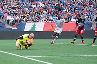 FOXBOROUGH, MA - JULY 25: Brad Knighton #18 of New England Revolution saves a shot on goal during a game between CF Montreal and New England Revolution at Gillette Stadium on July 25, 2021 in Foxborough, Massachusetts.