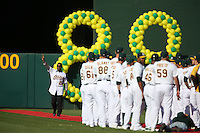 OAKLAND, CA - JULY 19:  Rickey Henderson #24 of the 1989 Oakland A's celebrates their World Series championship 25 years ago, before a game against the Baltimore Orioles at O.co Coliseum on July 19, 2014 in Oakland, California. Photo by Brad Mangin
