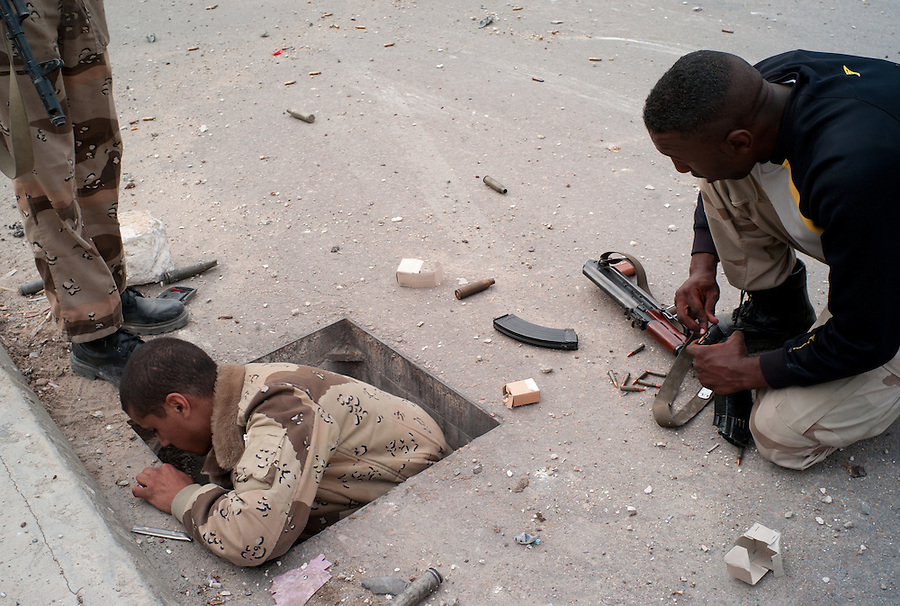 Anti-Gaddafi fighters discover hidden ammunition in a sewer drain in Sirte, Libya.
