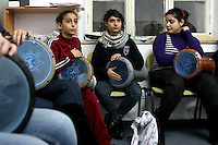 """FOR FAOIROUZ SONG """"THE FLOWER OF THE CITIES"""" - Palestinians take part in a Darbuka drum lesson in the Edward Said National Conservatory of Music in East Jerusalem. Photo by Quique Kierszenbaum."""
