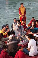 India, Rishikesh.  Worshippers at Evening Prayer (Aarti) at Parmarth Niketan Ashram.