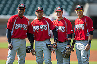 (L-R) Carlos Franco (10), Johan Camargo (2), Dustin Peterson 46, and Joey Meneses (44) pose for a photo prior to the game against the Winston-Salem Dash at BB&T Ballpark on April 22, 2015 in Winston-Salem, North Carolina.  The Dash defeated the Mudcats 4-2..  (Brian Westerholt/Four Seam Images)
