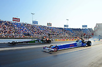 Jul. 1, 2012; Joliet, IL, USA: NHRA top fuel dragster driver T.J. Zizzo (right) races alongside Hillary Will during the Route 66 Nationals at Route 66 Raceway. Mandatory Credit: Mark J. Rebilas-