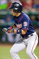 Minnesota Twins shortstop Tsuyoshi Nishioka #1 attempts a bunt during a Major League Baseball game against the Texas Rangers at the Rangers Ballpark in Arlington, Texas on July 27, 2011. Minnesota defeated Texas 7-2.  (Andrew Woolley/Four Seam Images)
