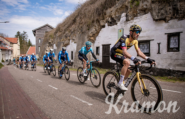 """peloton led by Paul Martens (DEU/Jumbo-Visma) passing some old """"rock houses""""<br /> <br /> 55th Amstel Gold Race 2021 (1.UWT)<br /> 1 day race from Valkenburg to Berg en Terblijt; raced on closed circuit (NED/217km)<br /> <br /> ©kramon"""