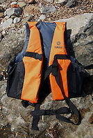 Mitylini / Lesbos / Greece 06/04/2016<br /> Mitilini beach. A life jacket used by refugees in case of shipwreck.<br /> Photo Livio Senigalliesi