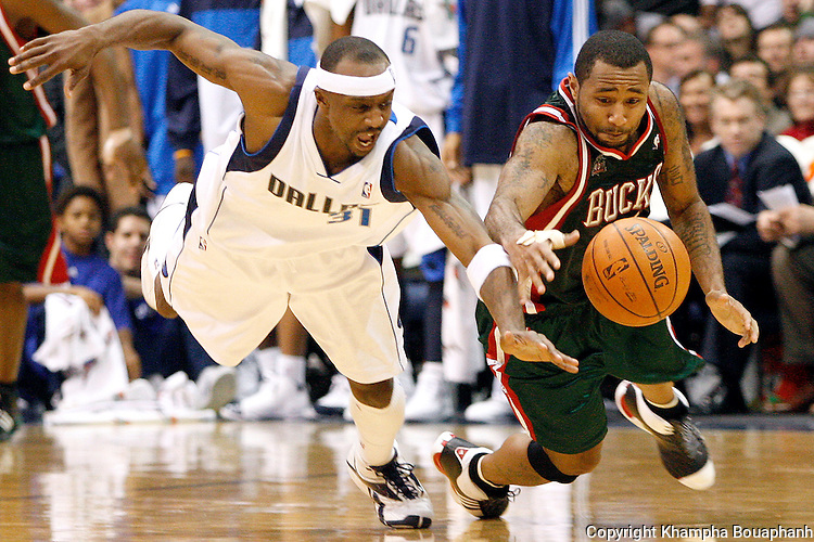 Dallas Mavericks' Jason Terry, left, goes for a steal against Milwaukee Bucks' Mo Williams in the second half of  an NBA basketball game in Dallas on Wednesday, February 6, 2008.  Dallas gained possesion on the play.  (photo by Khampha Bouaphanh)