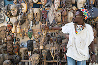 Dakar, Senegal.  Vendor of Carved African Masks, for sale as Souvenirs.