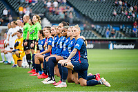 TACOMA, WA - JULY 31: OL Reign kneel together before the national anthem during a game between Racing Louisville FC and OL Reign at Cheney Stadium on July 31, 2021 in Tacoma, Washington.