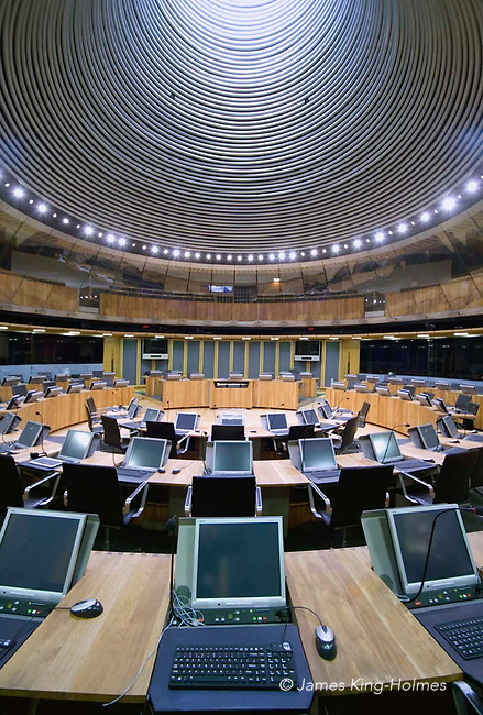 The debating Chamber or Senedd of the National Assembly for Wales in Cardiff showing the funnel lighting from the cowl