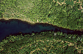 Amazon, Brazil. Aerial view of a deep blue river flowing through the green jungle.