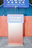A podium with a Trump campaign sign stands empty on the stage before Donald Trump, Jr., son of president Donald Trump and a rising Republican political star, speaks at an outdoor campaign rally at The Lobster Trap in North Conway, New Hampshire, on Thu., Sept. 24, 2020.