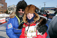 Saturday March 17, 2007  - Nome, Alaska ----   Tekla Monson, daugther of the late Susan Butcher, honorary musher of the 2007 race, arrives under the Nome burl arch finish line after her and her and her father, David Monson mushed 700 miles from Susan and Dave's old homestead at Manley Hot Springs.