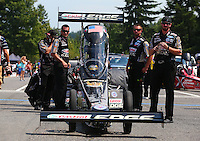 Aug. 2, 2014; Kent, WA, USA; Crew members with NHRA top fuel dragster driver Brittany Force during qualifying for the Northwest Nationals at Pacific Raceways. Mandatory Credit: Mark J. Rebilas-